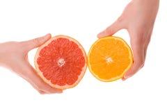 Hands holding sliced orange and grapefruit Stock Photo