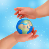 Hands is holding small earth Royalty Free Stock Photos