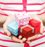 Hands holding small gifts Royalty Free Stock Photography