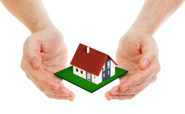 Hands holding small house concept. Hands holding small house isolated on white Stock Images
