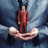 Holding small businessman Stock Photo