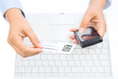 Hands holding smart phone and business card with qr code Royalty Free Stock Photos