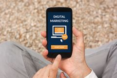 Hands holding smart phone with digital marketing concept on screen. All screen content is designed by me. Flat lay stock images