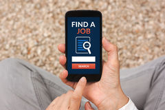 Hands holding smart phone with find a job concept on screen Stock Images