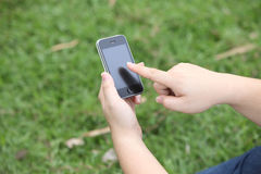 Hands Holding the Smart Phone and Index Finger using the Touch S Stock Photography
