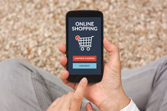Hands holding smart phone with online shopping concept on screen Royalty Free Stock Photography