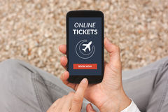 Hands holding smart phone with online tickets concept on screen Royalty Free Stock Photography