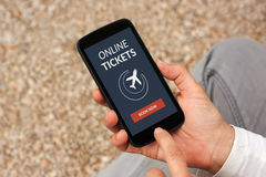 Hands holding smart phone with online tickets concept on screen Royalty Free Stock Image