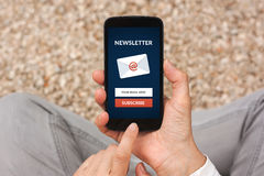 Hands holding smart phone with subscribe newsletter concept on s Royalty Free Stock Image