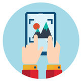 Hands holding smart phone, tablet, video and photo camera. Royalty Free Stock Photo