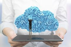 Hands holding smart tablet. Businessman climbing blue characters cloud shape royalty free stock photography