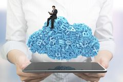 Hands holding smart tablet. Businessman sitting blue characters cloud shape stock photography