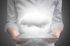 Hands holding smart tablet with white cloud stock images