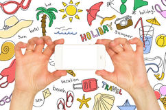 Hands holding a smartphone. Around summer sketches Stock Photos