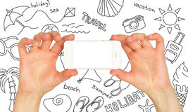 Hands holding a smartphone. Around summer sketches Stock Photo