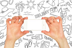 Hands holding a smartphone. Around summer sketches Royalty Free Stock Photos