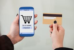 Hands holding smartphone and credit card Stock Images
