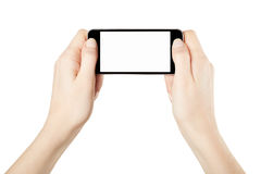 Hands holding smartphone device gaming. Isolated on white, clipping path included Stock Images