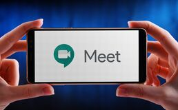 Free Hands Holding Smartphone Displaying Logo Of Google Meet Stock Images - 186517124