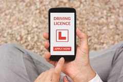 Hands holding smartphone with driving licence application mock u Stock Photography