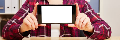 Hands holding a smartphone with an empty touchscreen Royalty Free Stock Image
