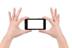 Hands holding smartphone. Isolated on a white background Stock Photography