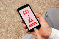 Hands holding smartphone with online dating application mock up Royalty Free Stock Images