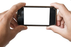 Hands holding smartphone, in playing game or watching movie or taking photo position royalty free stock image