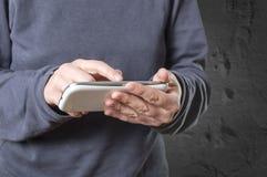 Hands holding smartphone Stock Photo
