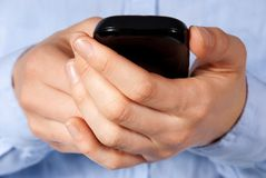 Hands holding a smartphone Royalty Free Stock Photography