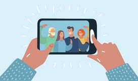Hands holding smartphone with young smiling people Royalty Free Stock Photography