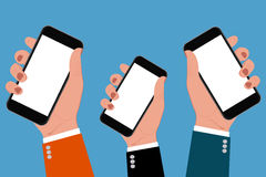 Hands holding smartphones, vector illustration. Vector illustration of hands holding smartphones Royalty Free Stock Images