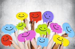 Hands Holding Smiley Faces Icons Stock Image