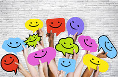 Hands Holding Smiley Faces Icons Stock Photos
