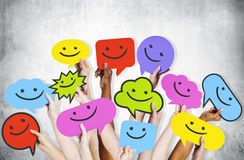 Hands Holding Smiley Faces Icons Royalty Free Stock Photography