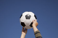 Hands holding a soccer ball Royalty Free Stock Image