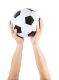 Hands holding soccer ball Royalty Free Stock Image