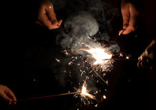 Hands holding sparklers Stock Photography