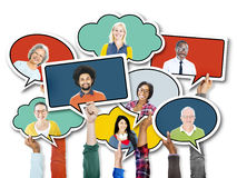 Hands Holding Speech Bubbles with Faces Royalty Free Stock Photography