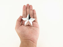 Hands holding star Royalty Free Stock Images