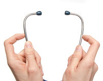 Hands holding a stethoscope Royalty Free Stock Photos