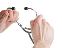 Hands holding a stethoscope isolated on white Royalty Free Stock Photo