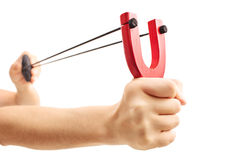 Hands holding a stretched slingshot  isolated on white backgroun Stock Photography