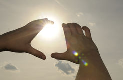 Hands holding the sun Royalty Free Stock Image
