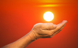 Hands holding the sun. Royalty Free Stock Photos