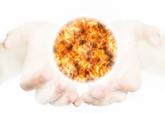 Hands holding a sun. Stock Photo