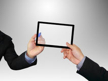 Hands holding a tablet. With clipping path Royalty Free Stock Photo