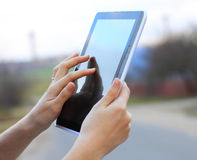 Hands holding a tablet Royalty Free Stock Photo