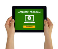 Hands holding tablet with affiliate program concept on screen. Hands holding digital tablet computer with affiliate program concept on screen. Isolated on white Stock Images