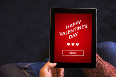 Hands holding tablet computer with valentine`s day concept on sc royalty free stock photos